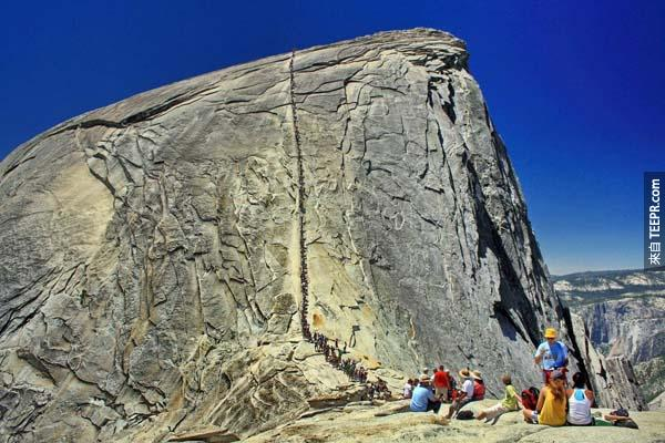 """8.) Yosemite's Half Dome Trail (USA): The Dome's peak is nearly 5,000 feet above Yosemite Valley and 8,800 feet above sea level. The Half Dome is a Yosemite icon and a great challenge to many hikers. Despite an 1865 report declaring that it was """"perfectly inaccessible, being probably the only one of the prominent points about the Yosemite which never has been, and never will be, trodden by human foot,"""" George Anderson reached the summit in 1875, in the process laying the predecessor to today's cable route."""