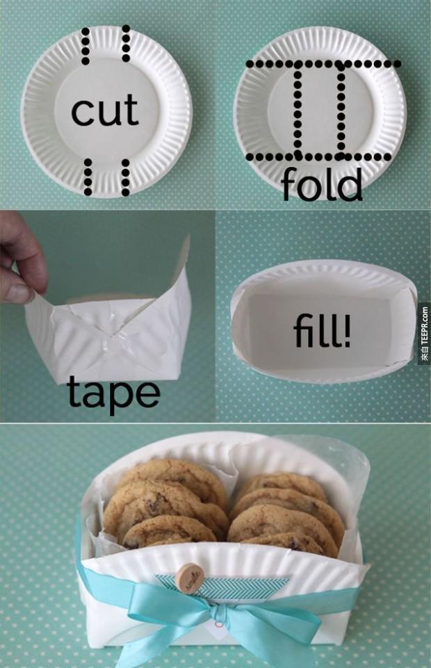 27. 用纸盘子做成的食物篮子。