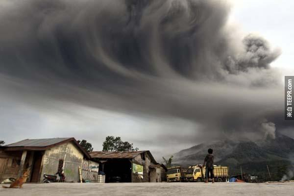 An Indonesian child watches with awe as ash spewed from the top of Mt. Sinabung.