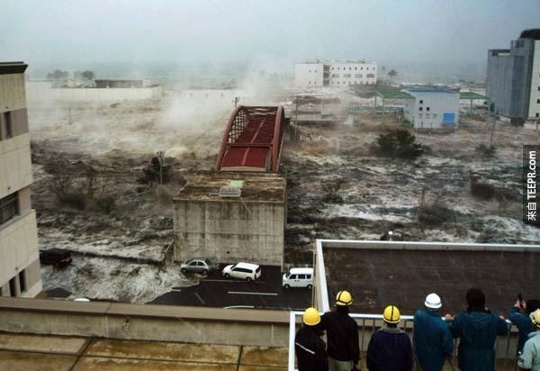 16.) Tsunami flood waters destroy cities in Japan.