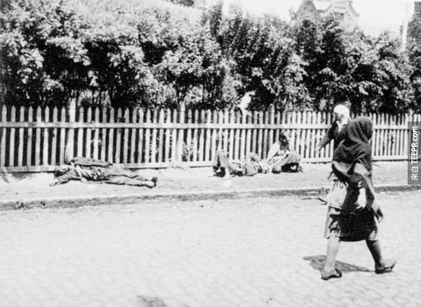 7.) The Holodomor: This Ukranian famine was one of the worst in history. It was a manmade event and recognized as a genocide of millions (comparable to the Holocaust). This is Kharkiv in 1933. Corpses lie in the street, while passers by just go about their day.