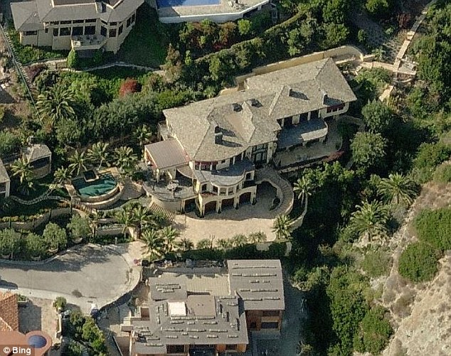 Mr El-Erian, 56, said that since stepping down from his job, he is available to make his daughter's breakfast and run her to school from their mansion in California (pictured)