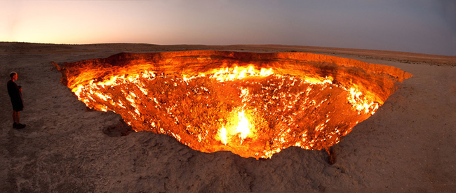 """10.) There is a cave of natural gas in Turkmenistan known as the """"Door to Hell."""" In 1971, scientists lit the cave on fire expecting it to burn for a few days. It's still burning."""