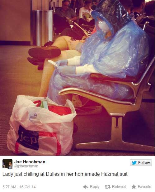 伊波拉倒底有多嚴重?!光看這名女子在機場穿的一身自製盔甲就知道了。