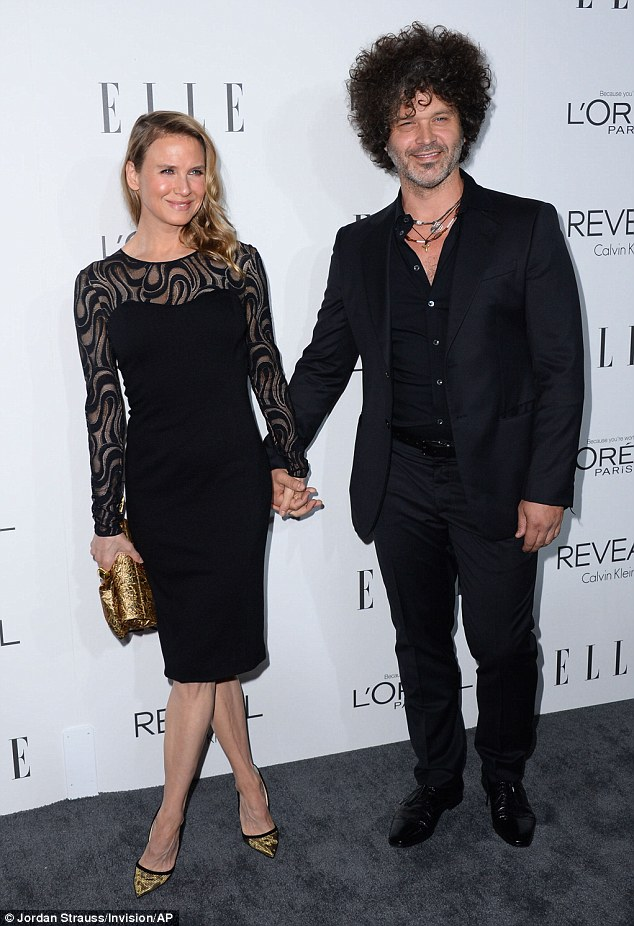 Affectionate: Renee was joined by musician boyfriend Doyle Bramhall II at the event at the Four Seasons Hotel in Los Angeles