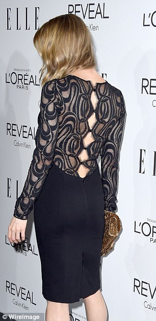 So chic: The Bridget Jones star hit the right note with a black knee-length dress with sheer embroidered back and sleeves