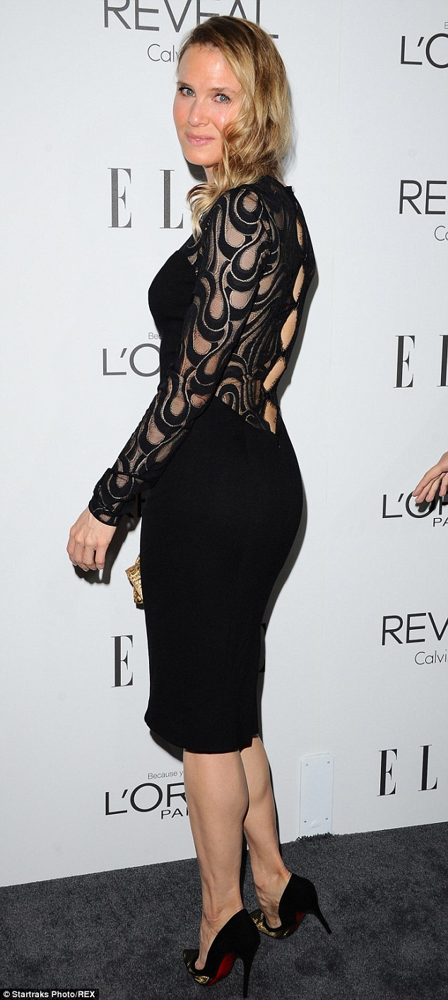 Modelling: The actress turned around to show-off the intricate cut-out detailing down her back