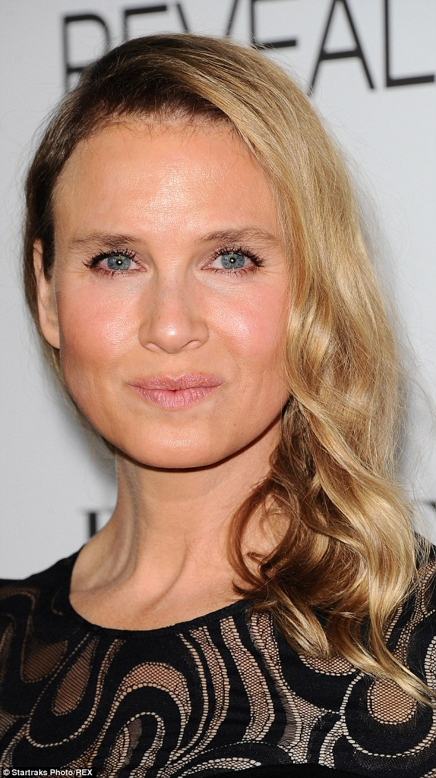 Not a line in sight:Renee Zellweger's suspiciously puffy face set tongues wagging when she stepped out at the  ELLE's 21st annual Women In Hollywood Awards on Monday