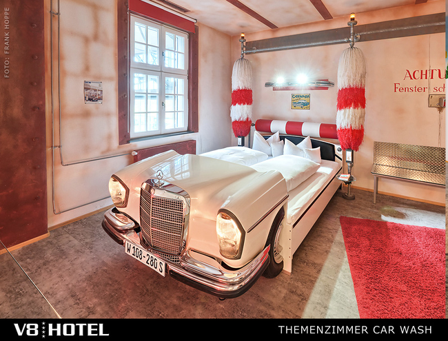 Who says you're too old for a car bed? Everyone? Well, not at the V8 Hotel. This hotel is entirely car-themed, with rooms designed around classic, vintage, and modern autos.