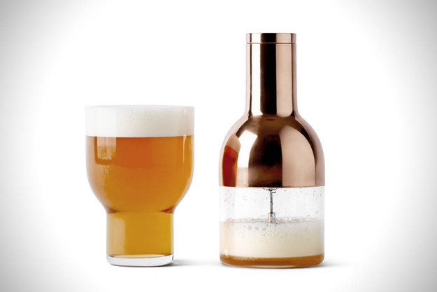 Drinking beer from a bottle at home will never be the same as getting a pint at a bar... unless you have this beer foamer.