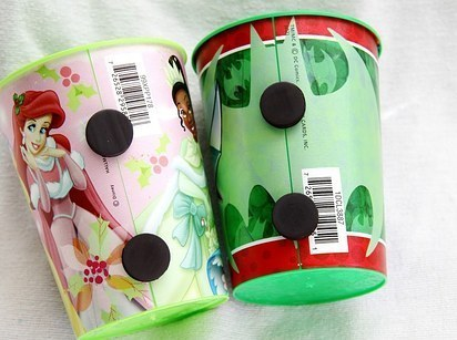 Put magnets on your kid's cups so that they stick to the fridge.