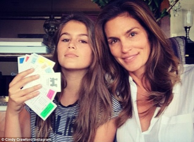 Following in her pretty footsteps: Truly her mother's mini-me, Kaia modeled in a Teen Vogue spread last November, and she scored a Young Versace campaign at age 10