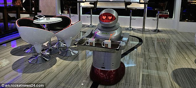 The eventual decline in jobs will limit what young people can save and invest. This means less capital will be available for the future generations and means production could actually fall over time, despite the fact machines are capable of producing goods more efficiently. A robot hotel employee in China is shown