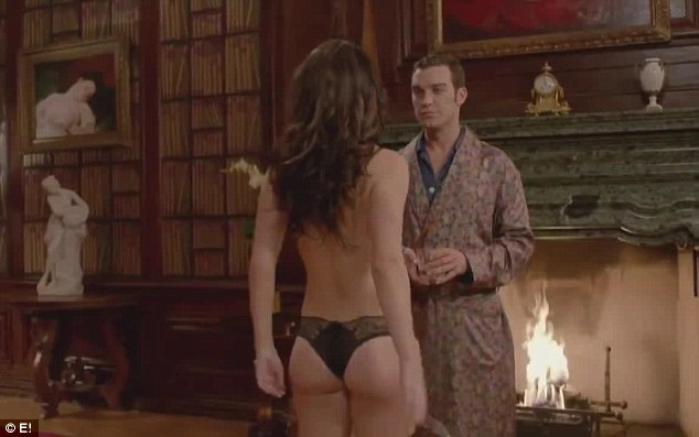 Cheeky: Elizabeth Hurley plays Queen Helena in new show The Royals and strips down to just her lingerie for the sequel
