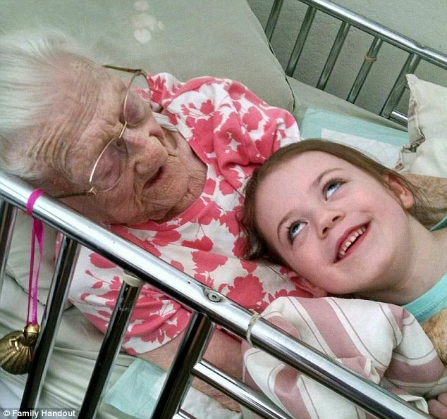 Rosa and her 5-year-old great-granddaughter Mackenzie snuggle on her bed last month