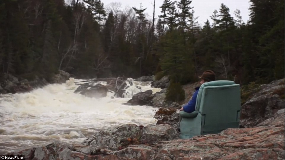 Mr Kallai takes time to pose precariously on a river bed while journeying across Canada