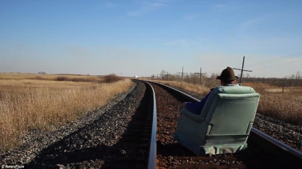Mr Kallai videos himself sitting on a railway track on the chair he acquired from online advertisement site Kijiji