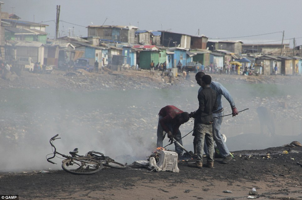 Aid: UNU believes legal shipments of electronic appliances can help people in Africa who burn components (pictured)to extract scrap metal which they can sell