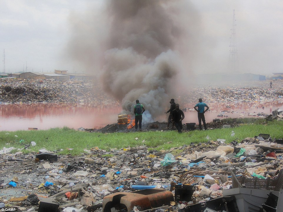 Polluted: 'Millions of tonnes' of the world's e-waste ends up in Africa where it is dumped in landfills like Agbogbloshie (pictured) in Ghana's capital Accra