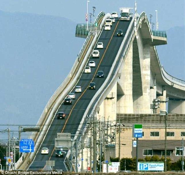 The Eshima Ohashi bridge in Japan – the third largest of its kind in the world – rises sharply so ships can pass underneath