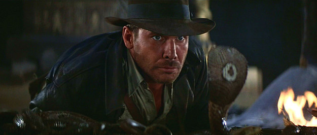 In Raiders of the Lost Ark you can see the snake's reflection in the glass separating it from Indiana Jones.
