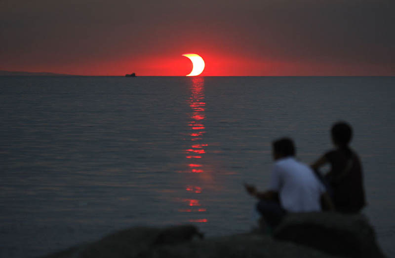 An eclipse and a sunset happening at the same time.