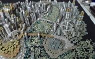 這名男子花了一個月用5萬枚錢幣堆出無比壯觀的中國重慶市!