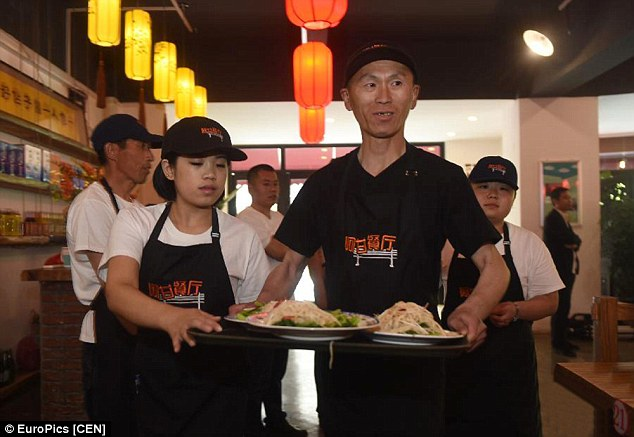 A restaurant has opened in China offering jobs to those with learning difficulties. They will be working as waiters alongside regular workers