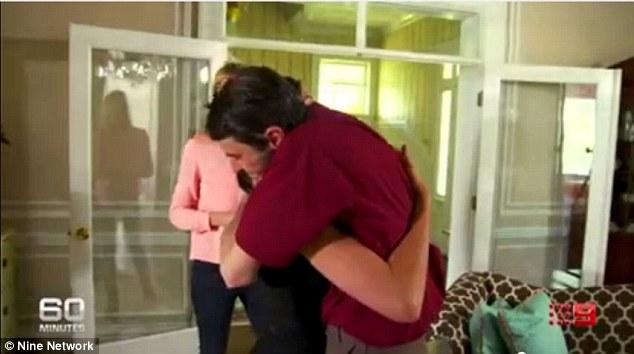 Emotional: Richard Norris and Rebekah Aversano embrace, the reunion proving overwhelming