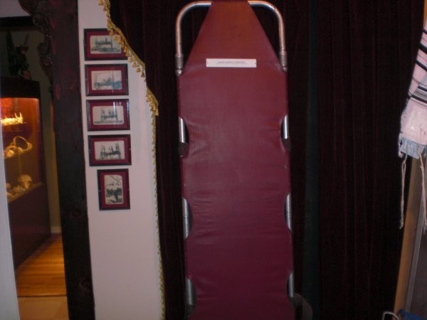 The museum is populated with instruments and symbols of death, like this stretcher.