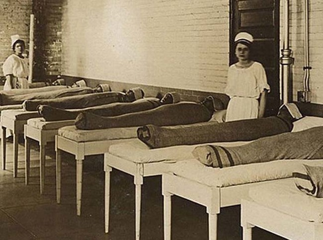 Here's one of the many bizarre, unfortunate ways that doctors used to treat the mentally ill. Each patient here is wrapped in a wet sheet.