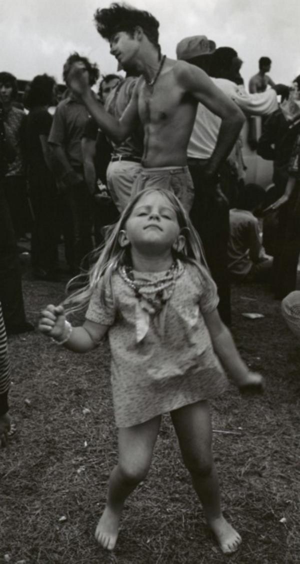 A little girl dancing in Woodstock in 1969.
