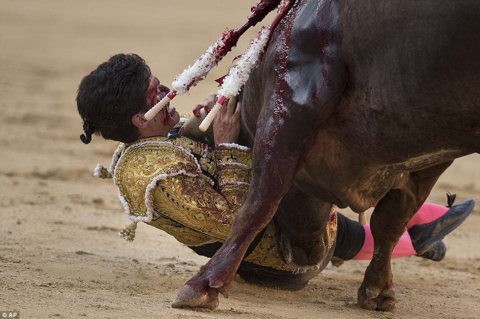 Desperate moments: A blood-soaked Sanchez tries to pull the horn out of his chest while howling in pain