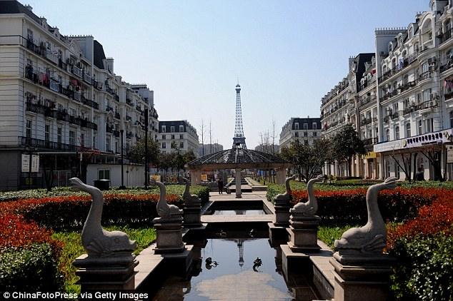 Hangzhou's knock-off Paris, above,  features the Eiffel Tower and Champs-Élysées, and was built on farmland