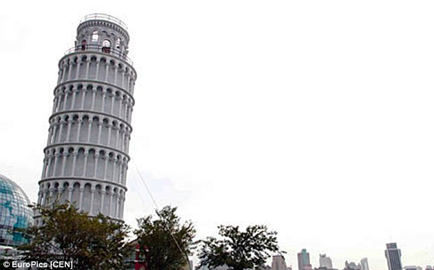 Shanghai's version of the leaning tower of Pisa, pictured in the financial district, is held in position by wires