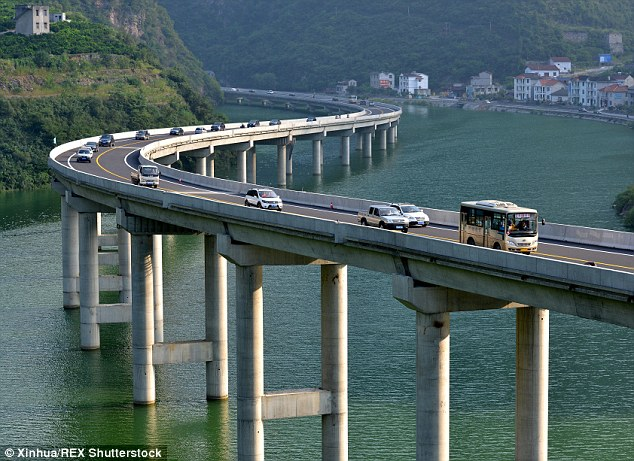 Incredible images of the new road shows that drivers are literally travelling over water as it is built on a bridge