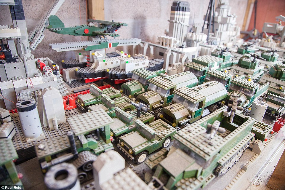 He has even built accompanying military transport for the ships.The 51-year-old, has a garage crammed with a flotilla of battleships, aircraft carriers, planes, fishing vessels and landing craft - each one painstakingly built from Lego
