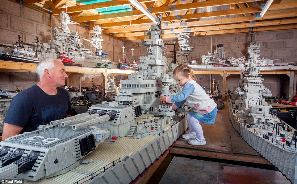 Mr McDonough  and grandaughter Leigha with the USS Missouri (left).Mr McDonough prides himself on not gluing them together - which he regards as 'cheating'