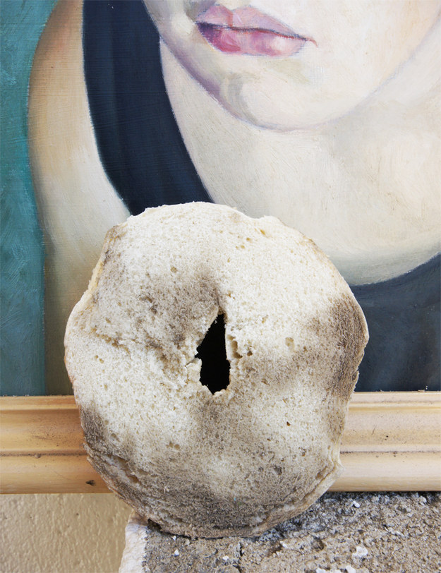 Rub down old paintings with half a bagel.