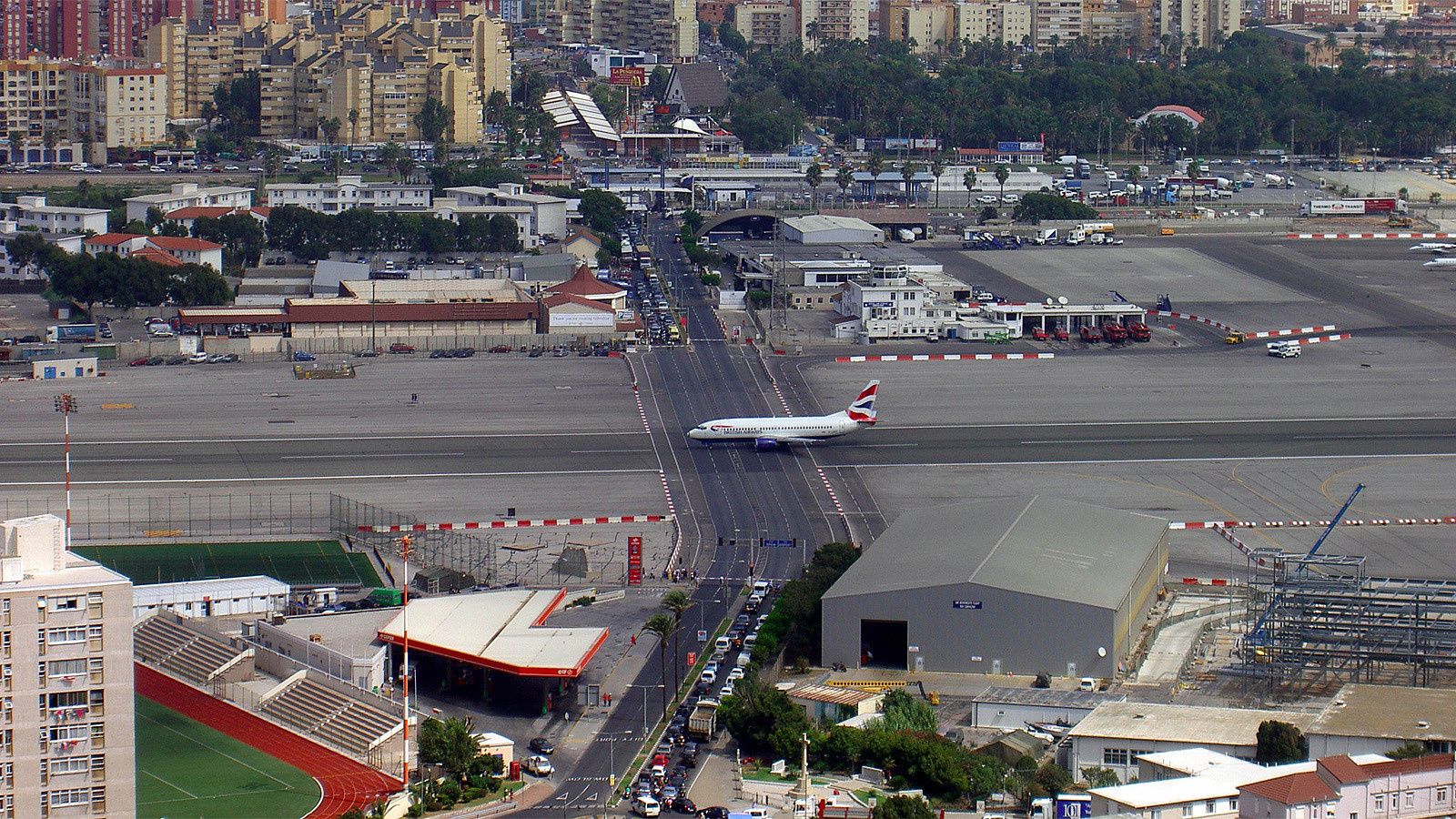 The runway at the Gibraltar International Airport has a regular road crossing through it.