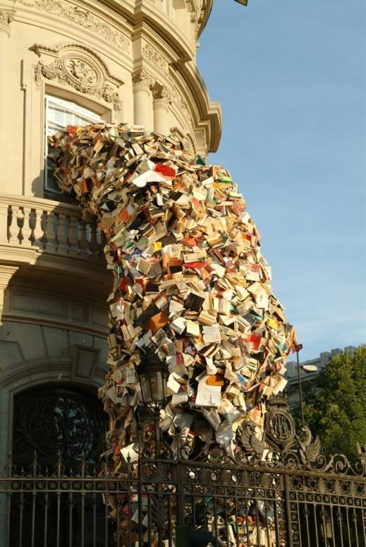 Madrid-based artist Alicia Martin transforms thousands of books into towers that pour out of windows and into the streets.