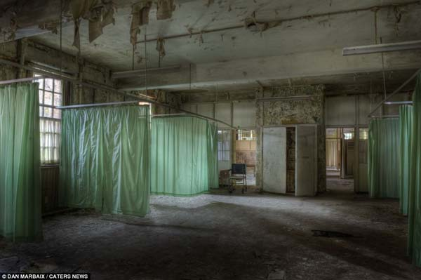 No matter how many times he has been threatened or arrested, Dan thinks it's all worth it. These haunting photos from an abandoned asylum prove his point.
