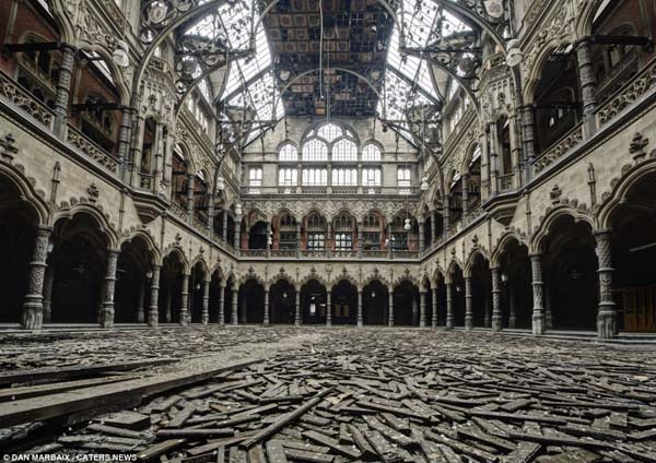 The Chambre du Commerce in Antwep, Belgium, was erected in 1872 as a reconstruction of a 1531 Stock Exchange. It stopped being used because it didn't meet safety regulations and it is a HUGE draw for urban explorers.