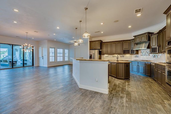 It boasts four bedrooms/bathrooms, and a crisp new kitchen.