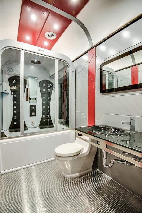 Even the bathroom, which has a Jacuzzi tub and a jetted shower, follows the theme.