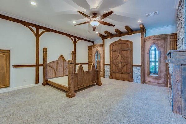 """The fantasy doesn't stop at """"Star Trek."""" The master bedroom is decorated like a medieval castle."""