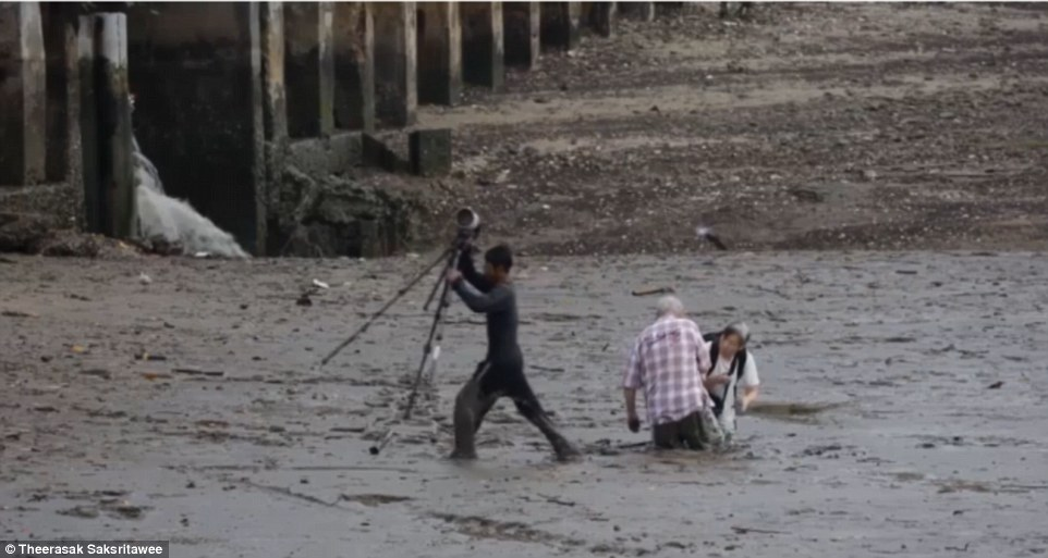The quick-thinking fisherman first lifted the couples photography gear and rucksacks to higher ground