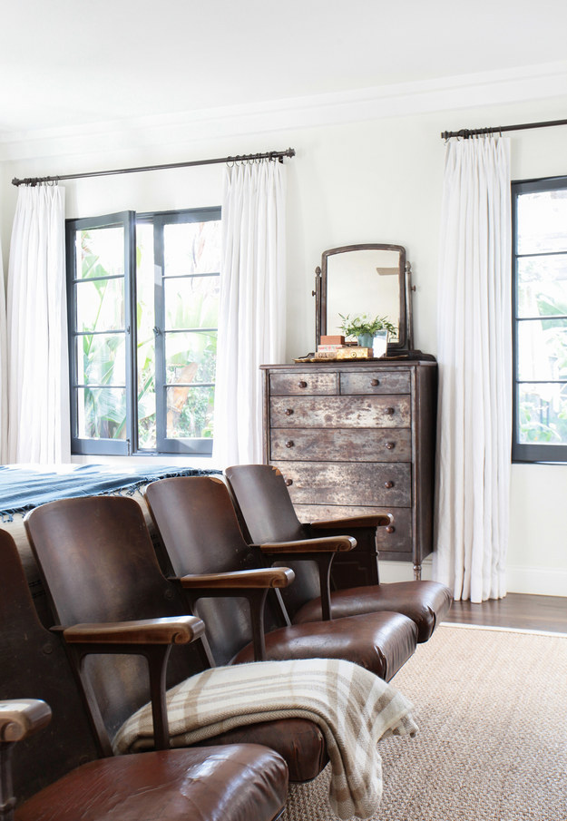 """To make your windows (and room) look bigger, hang curtains in between the ceiling and the top of the window, with a rod that extends 6-10"""" on either side."""