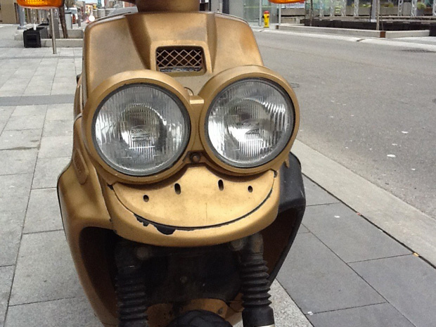 A tiny moped that could not be happier.