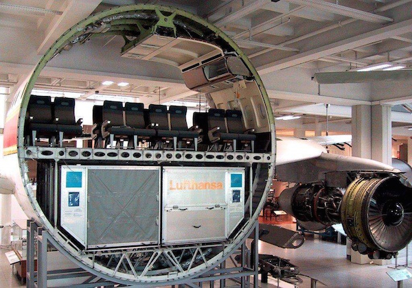The cross section of an airplane that has been pulled apart.